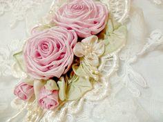 Image from http://lambsandivydesigns.theweddingmile.com/uploads/import-Bride_s_Princess_Ribbonwork_Cuff_Bracelet_Wrist_Corsage_Pink_Roses_Hand_Flower-8c3387b16a695a46842339e81fde811f.jpg.