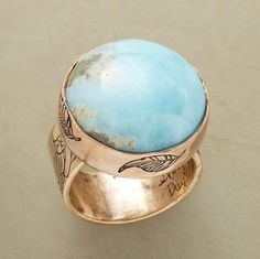 Jes MaHarry sets a rare sky blue Larimar cabochon, found only in the Dominican Republic, in a 14kt recycled rose/yellow gold bezel on an engraved rose gold band, to benefit the Natural Resources Defense Council. Made in USA. Exclusive. Whole sizes 5 to 9.