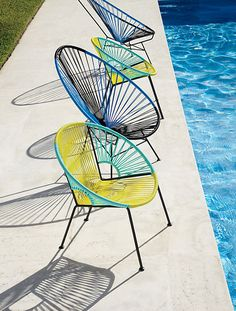 From CB2: the Acapulco Black/Blue Lounge Chair and the Ixtapa Yellow/Aqua Lounge Chair. With a '50s look and an undeniable contemporary feel, these modern chairs are handwoven with PVC cord over a powder coated steel frame. Modern Outdoor Chairs, Outdoor Garden Furniture, Modern Patio, Cool Chairs, Patio Chairs, Table And Chairs, Lounge Chairs, Furniture Making, Cool Furniture