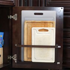 An Improvised Cutting Board Holder behind the cabinet door!