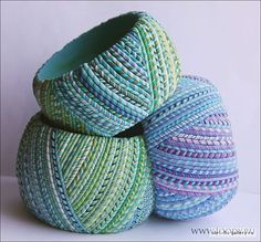 at first glance thought, wrapped handspun yarn. But on closer look, it's lovely polymer. Ropes instead of canes!