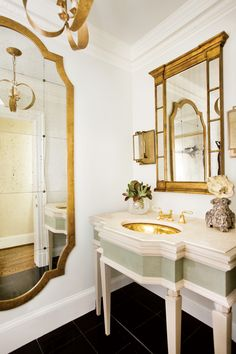 Splendor in the Bath. Black, white, and gold. Interior Designer: Janie K. Hirsch.