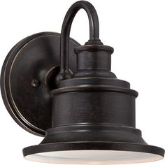 Cast a warm glow on your front porch or patio with this stylish wall sconce, showcasing a steel frame and an imperial bronze finish.P...