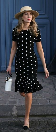 Black dress with white polka dots, red lips, straw hat. Modest summer outfit with a vintage look