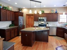 Rust-Oleum Cabinet Transformations® - RUSTIC color  from oak cabinets to this