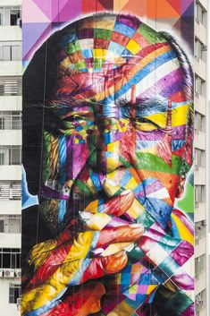 """By Kobra in São Paulo, Brazil. Photos by Alan Teixeira. """"Brazilian street artist Eduardo Kobra is currently finishing his tribute to the Brazilian architect Oscar Niemeyer, who passed away last december at the age of 104. The new mural is 52 meters tall, 16 meters wide and it covers the entire side of a skyscraper on Paulista Avenue."""