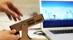 Take out those evil piggies in style with Super Angry Birds, a prototype physical slingshot controller that brings the physics battle into the real world. http://cnet.co/MPOU8X