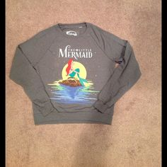 Long sleeve top This is a cross between a sweater and a sweatshirt. It is in very good condition and I don't think it was ever worn. There are no tags with it though and it is an authentic Disney item. Disney Tops