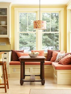 Mix it up. Try pairing several shades of orange, peach and brown for a cozy breakfast nook.