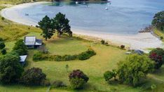 The campground is only accessible by boat - the island provides a water taxi service if you don't have your own. Tent Pegs, New Zealand, Golf Courses, Road Trip, Boat, Camping, Island, Taxi, Slipper