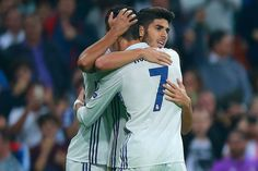 Marco Asensio of Real Madrid celebrates scoring his team's third goal with his team mates Cristiano Ronaldo during the UEFA Champions League Group F match between Real Madrid CF and Legia Warszawa at Bernabeu on October 18, 2016 in Madrid, Spain.
