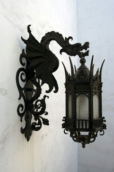Black wrought iron dragon lanterns for either indoor/outdoor lighting.