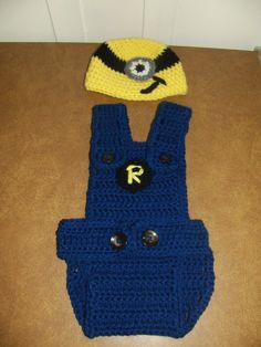 """Hubby and I have a new nephew so I made up a cute minion outfit for baby Robert. Since most of the good patterns for minion style overalls are a """"paid"""" pattern I had to make my own. Here's the resu..."""