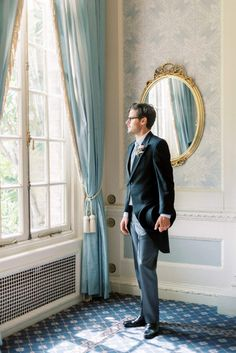 hedsor house spring summer wedding; black groom top hat; armani long coat with pale blue vest and neck tie pin stripe trousers   Photo by London and Newcastle UK based light bright and airy Filipina wedding photographer Cristina Ilao