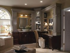 The contrast of Tidal Mist and Chocolate finishes on Schrock's Princeton cabinets makes this luxurious bathroom the perfect blend of masculine and feminine elements. Sculpted valances, leaded glass and detailed mouldings create a space that exudes grandeur. #SchrockBathrooms