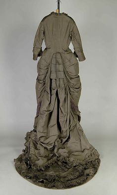 Silk wedding dress with purple fringe trim (back), American, 1887.