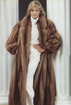 Liz in her new mink. She bought it after she won her first big case.