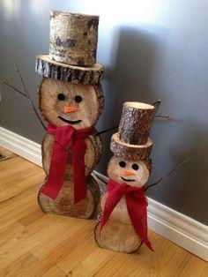 Tree trunk snowmen