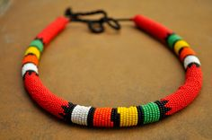 This extra thick traditionally hand beaded necklace can also be worn as a striking African headpiece.  akwaabaAfrica