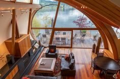"Architect Robert Oshatz's floating house project From view of the Fennell residence, a floating house with a copper roof and mahogany deck designed in 2001 by architect Robert Harvey Oshatz and built in 2005, that sits on the Willamette River in Portland. As Oshatz describes the house, its design evokes ""the poetry of the ripples and contours of a river""."