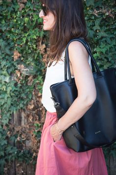 Ashley from Hither & Thither shares tips and tricks on staying focused and motivated while working out-of-the-office and tending to the needs of her two growing toddlers. Read more, see what's in her bag and shop all stylish work bags for women.
