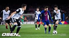 Lionel Messi of FC Barcelona conducts the ball under pressure from Carlos Soler of Valencia CF during the Copa del Rey semi-final first leg match between FC Barcelona and Valencia CF at Camp Nou on February 2018 in Barcelona. Barcelona Futbol Club, Fc Barcelona, Messi Photos, Camp Nou, Professional Football, Semi Final, Under Pressure, Lionel Messi, Valencia