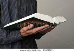 KAZAN, RUSSIA - JULY 11, 2015: Man's hands holds Koran - holy book of muslims, shallow depth of field. - stock photo