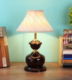 Buy Modern and Contemporary Table Lamps - White Fabric Shade Table Lamp with Brown Base by BrightDaisy - Pepperfry Online - Ensuring an optimal distribution of light on the desk, these study lamps offers a well-lit-up study table. These lamps not only look stylish but also have high efficiency to brighten up the study desk. A one stop-shop for home decor and furniture, Pepperfry sells a home product every 30 seconds. Study Lamps, Study Desk, Contemporary Table Lamps, White Table Lamp, Fabric Shades, 30 Seconds, Lamp Bases, White Fabrics, Light Up