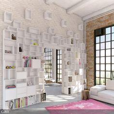 Eine Wandgestaltung mit einem Regalsystem (von Cubit) füllt nicht nur die hohen Decken eines Lofts aus, sondern bietet auch viel Stauraum. Bei hellen, natürlichen…