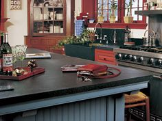 Kitchen Soapstone Countertops If you spent any time in high school chemistry class, you probably remember the Bunsen Burners… and the table they sat on. If you recall the table top, then this isn't your first exposure to soapstone. Soapstone has been a Slate Countertop, Soapstone Counters, Granite, Affordable Countertops, Kitchen Facelift, Colonial Kitchen, Operation, Home Decor Kitchen, Kitchen Ideas