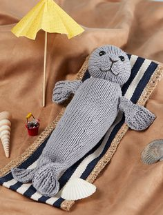 """Knitting Pattern for Silky the Seal - Toy Finished Size 12"""" long. Also comes with patterns for Mermaid and Merboy toys. #ad Click the pin image to see more pics and get the pattern at Interweave. Use WEAVE15 to get 15% off. Also available in Knit and Crochet Toys book from Interweave"""