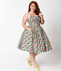 Weve got a ticket to ride, dears! A gorgeous admission from Bernie Dexter, the Chelsea dress is an entertaining frock for a ride in the tea cups. Featuring a multicolor print of amusement park tickets, this soft lightweight cotton dress features a flatte