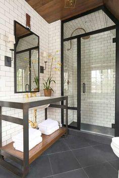 Bathroom color scheme - white subway tile on walls, dark floor, copper/brass fixtures