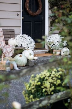 A warm and neutral farmhouse/cottage fall home tour. Outdoor patio with mums and pumpkins simple and festive for the season...