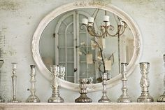 Old Mercury glass candle sticks, old mirror reflecting old French doors and an old chandelier on the background of Shabby Chic painted walls.  What's not to like?