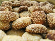 Benne Wafers Recipe    1 cup sesame seeds  3/4 cup butter, melted  1 1/2 cups packed brown sugar  1 egg  1 teaspoon vanilla extract  1 cup all-purpose flour  1/4 teaspoon salt  1/4 teaspoon baking powder