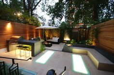 Kensington garden Central London garden with limestone paving, polished concrete benches and cedar trellis. Stunning lighting by Light IQ with back lit frosted glass panel Outdoor Areas, Outdoor Rooms, Outdoor Walls, Outdoor Living, Outdoor Decor, Gazebos, London Garden, Contemporary Garden, Garden Spaces