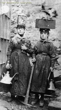 Women Coal Miners, 1890. Stove? on top of one woman's head....looks like they are both carrying kettles, along with of course a pick axe...........