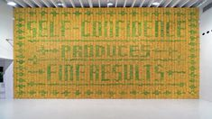 "Installation made of 10.000 bananas, Deitch Projects, NYC, 2008 | #Sagmeister Inc. ""Green bananas created a pattern against a background of yellow bananas spelling out the sentiment: Self-confidence produces fine results.  After a number of days the green bananas turned yellow too and the type disappeared. When the yellow background bananas turned brown, the type (and the self-confidence) appeared again, only to go away when all bananas turned brown."""