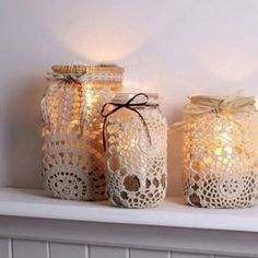 Great DIY mason jar lace decoration with ribbon! Okay, no wedding but pretty for a bookshelf with flamess candles Lace Mason Jars, Mason Jar Crafts, Mason Jar Diy, Mason Jar Lamp, Mason Jar With Lights, Diy Diwali Decorations, Home Decoration, Table Decorations, Doilies Crafts