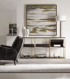 You won't have to sacrifice storage space for a simple, modern design with this sofa table. A brass frame holds three compartments with hinged lids for discreet storage, and the glass surface adds a touch of contemporary elegance. Add this to your home today and achieve the sleek modern look you've always wanted.