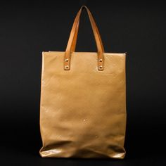 Louis Vuitton Lead Mm In Beige