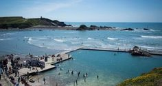 Famous for its pastel painted beach huts, crazy golf + wide sandy beaches, Bude is also popular for watersports + walking. Bude Cornwall, North Cornwall, Devon And Cornwall, Outdoor Swimming Pool, Swimming Pools, Praa Sands, British Beaches, St Just, Tourist Board