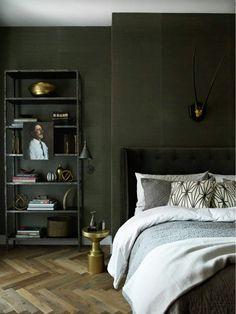 Dark green bedroom walls in a moody masculine Soho loft via @thouswellblog