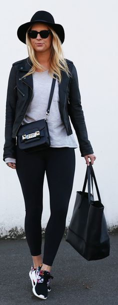 A long sleeved Tee, leather jacket and sneakers. Somewhat sporty with a twist of rock chic. Via Lisa Hamilton  Leather Jacket: Oak, Top: Oskar The Label, Leggings: Bonds, Sneakers: Nike, Hat: Janessa Leone, Bag: Proenza Schouler, Tote: J. Crew