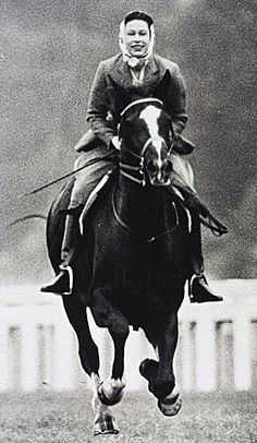 Queen Elizabeth II galloping at Ascot in 1964.