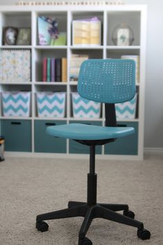 Spray paint desk chairs to match your decor.  She used Valspar Turquoise and has great instructions for how to spray prime plastic.