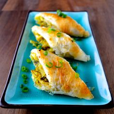 "These Curry Lime Chicken Phyllo Rolls were adapted from Ina Garten's Crab Strudel recipe, which is awesome, but I'm not an established TV personality who regularly throws around phrases like ""good olive oil"" and ""lunch in East Hampton,"" so lump crab meat isn't something that I'm shelling out money for very often."
