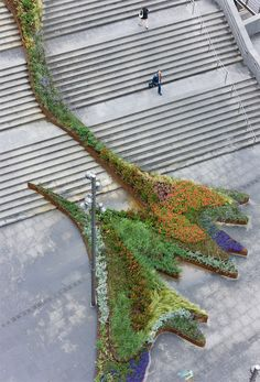 The Stair Climbing BILBAO JARDIN GARDEN, in Spain by Diana Balmori  The garden climbs the stairs, running in undulating lines of different textures and colors. Envisioned as a dynamic urban space; it moves in time and with the seasons.