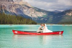 wedding photos with a canoe, emerald lake wedding, emerald lake lodge, emerald lake wedding photos, edmonton wedding photographer, wedding photos, wedding photography, happy wedding photos, bride and groom wedding photos, nc photography, romantic wedding photos